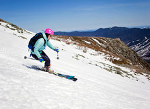 A Young Woman Skis Down The Al...