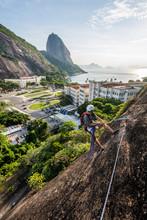 Man Rock Climbing Babilonia Mountain, Urca, Rio De Janeiro, Brazil
