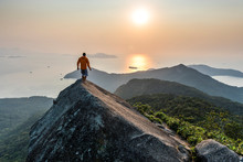 Man Trekking On Top Of Ilha Gr...