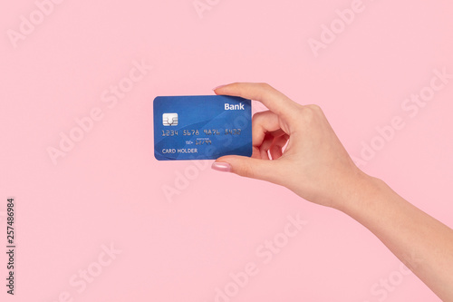 Obraz Crop girl with blue credit card  - fototapety do salonu