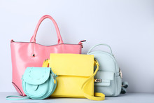 Fashion Handbags And Backpack On Grey Background