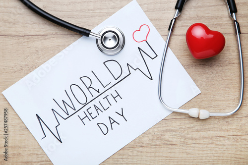 Fotografie, Obraz  Text World Health Day with stethoscope and red heart on wooden table