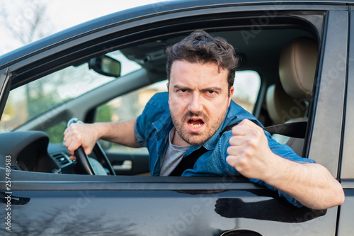 Driver frustrated portrait while driving his car Fototapeta