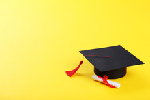 Graduation Cap With Diploma On Yellow Background