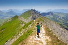 A Solo Male Hiker On A Mountai...
