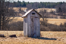 Outhouse In A Farmers Field