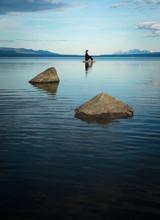 Woman Sitting Among Rocks In P...