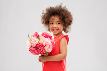 Childhood And People Concept - Happy Little African American Girl With Flowers Over Grey Background