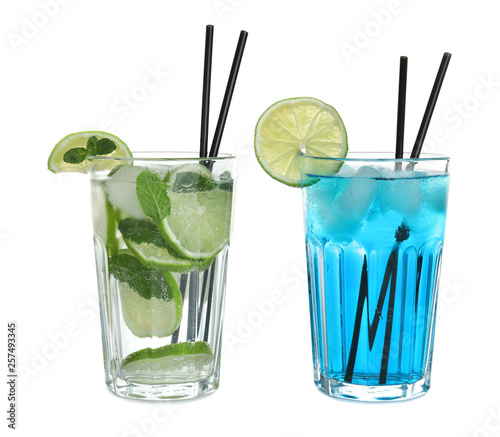 Tasty refreshing cocktails in glasses on white background Canvas-taulu