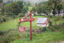 Sign Pointing Way To Mountain Farm Producing Cheese In Slovenia