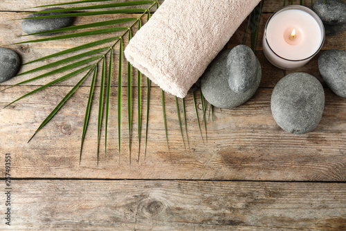 Papiers peints Zen Flat lay composition with zen stones, towel and candle on wooden background. Space for text