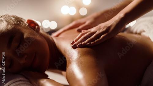Fotografie, Obraz  Girl receiving back massage in spa salon