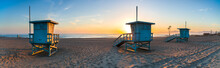 Deserted Lifeguard Stands On Beach During Sunset
