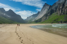 Two Hikers Leave Footprints In Sand At Horseid Beach