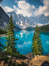 Standing Up Paddle Boarder Paddling On Moraine Lake In Banff National Park, Canada