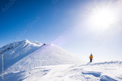 Mountain climber on snow covered mountain on sunny day at Mount Shasta, California, USA