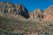 People Walking Towards Canyon In Red Rock Canyon National Conservation Area, Nevada, USA