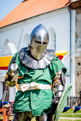 Foto op Aluminium Draken The man is in the costume of a medieval knight. Medieval knight is ready for battle_