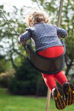 Backside Of Toddler Girl Swing...