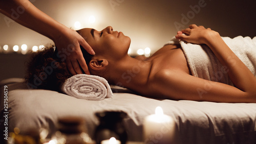 Poster Relaxation Girl having massage and enjoying aroma therapy in spa