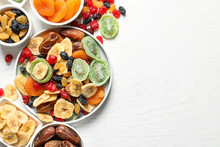 Bowls Of Different Dried Fruits On Wooden Background, Top View With Space For Text. Healthy Lifestyle