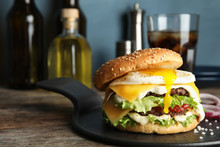 Tasty Burger With Fried Egg On Tray Against Blurred Background, Space For Text