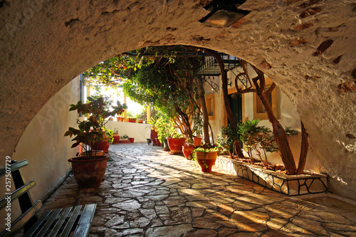 Interesting detail of a courtyard inside the monastery of the virgin Mary in Paleokastritsa