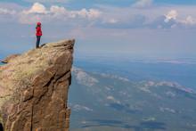 Climber On Rock Pinnacle In Ro...