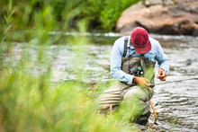 A Fly Fisherman Prepares His G...