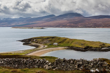 Clouds Over Stone Wall In Front Of Isolated Coastal House, Scotland, UK