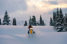Man Driving Snowmobile, Colorado, USA