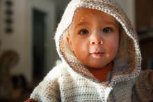 Portrait Of Baby Boy In Hooded Knit Sweater