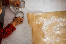Little Girl Playing With Cookie Cutters