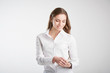 Young woman holding touchpad in her hand