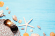 Blue sea background with hat, sunglasses and seashells, summer holiday and vacation time concept
