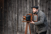 Old Fashioned Photographer Works With Large Format Camera. Concept - Photography Of The 1930s-1950s