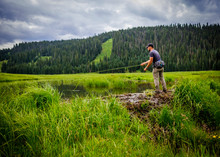 Man Fly Fishing In Beaver Pond, Hermosa Creek Valley, Colorado, USA