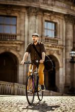 Man Riding Bicycle Inold Town