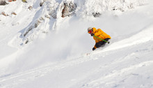 Man In Yellow Jacket Skiing
