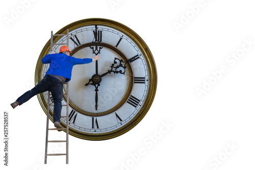 Man is standing on a ladder and adjusting the clock Canvas Print