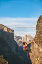 Climber On Rock, El Capitan And Half Dome In Background