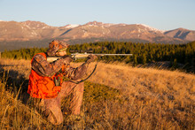 Male Hunter At Sunrise In Mountains