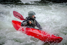 Whitewater Kayaker Paddling Th...