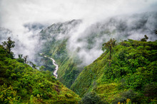 Tranquil Scene Of River Valley In Clouds