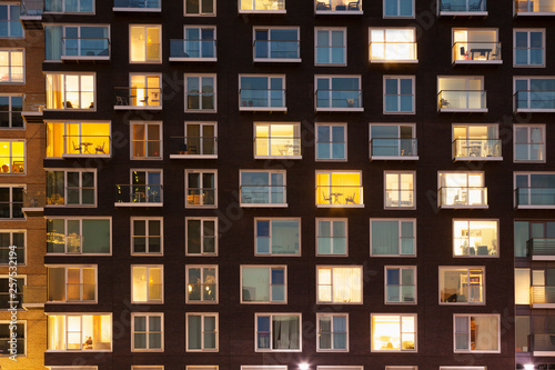 Modern apartment block at dusk Wallpaper Mural
