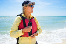 Woman Zipping Up A Life Vest