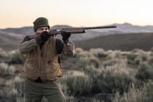 Chukar Hunter Aiming Gun, Nevada, USA