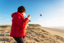 Boy Playing With Kite At Beach