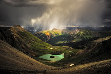 Storm Clouds Over Mountains An...