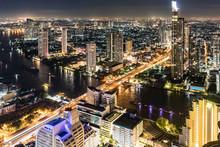 Thailand, Bangkok, Aerial View Of The City With Chao Phraya River At Night